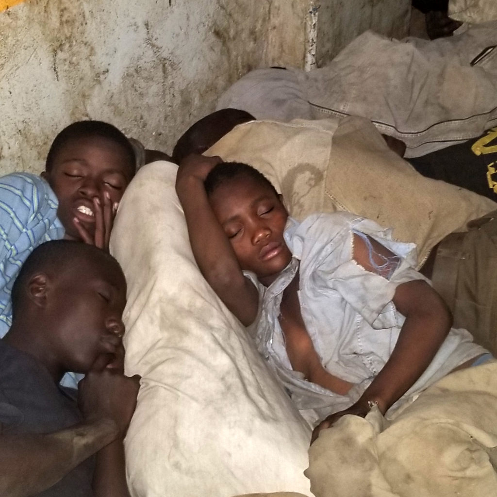 Boys sleeping on the street in Kisenyi, Kampala, Uganda.