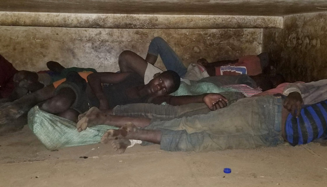 Boys sleeping under the street in Kisenyi, Kampala, Uganda.